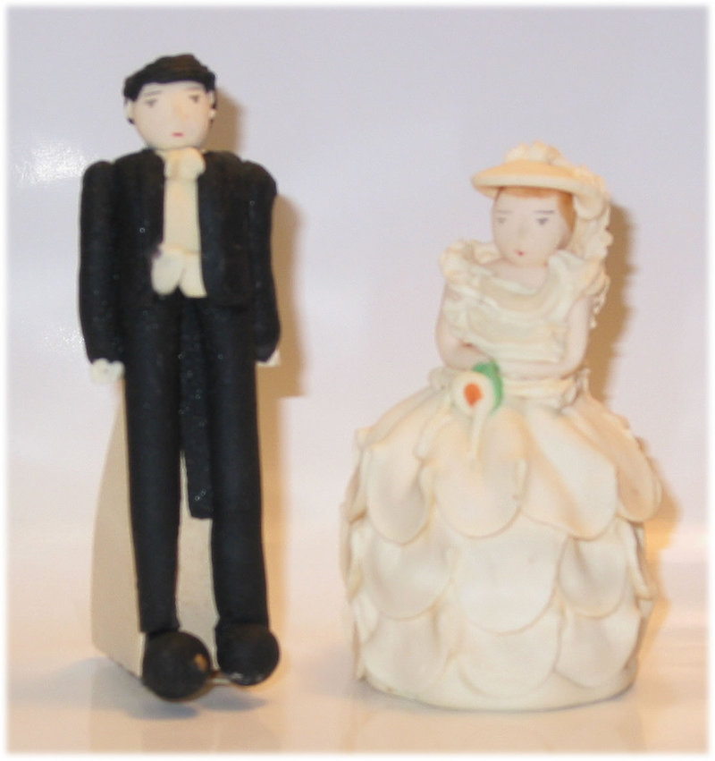 You can purchase these wedding cake toppers for 150 over at Fancy Flours